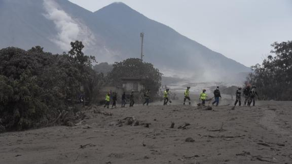 Rescuers search for victims in San Miguel Los Lotes, a village in Escuintla Department, about 35 kilometers southwest of Guatemala City.