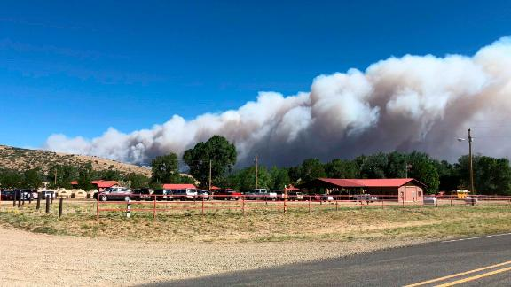 A plume of smoke from a wildfire rises behind Philmont Scout Ranch on June 1.