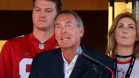 Dwight Clark, center, speaks during halftime at a  game between the 49ers and the Dallas Cowboys in October 2017.