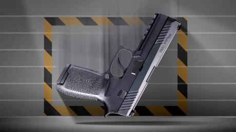 A photo illustration of a Sig Sauer P320 pistol falling with the trigger side up.