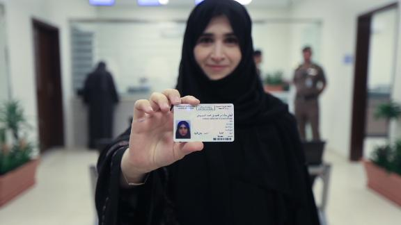 Tahani Aldosemani, Assistant Professor and Undersecretary of the Deanship of the Technology Department at Prince Sattam Bin Abdulaziz University in Al-Kharj, holds her new driving licence in a photo issued by the Kingdom of Saudi Arabia.