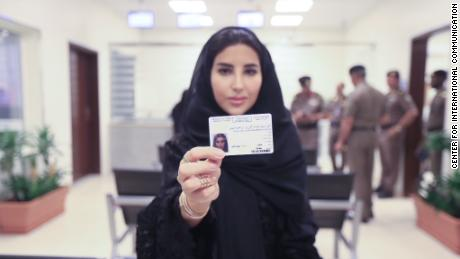Esraa Albuti, an Executive Director at Ernst & Young, smiles as she brandishes her brand new driving licences issued Monday June 4 by the Kingdom of Saudi Arabia.