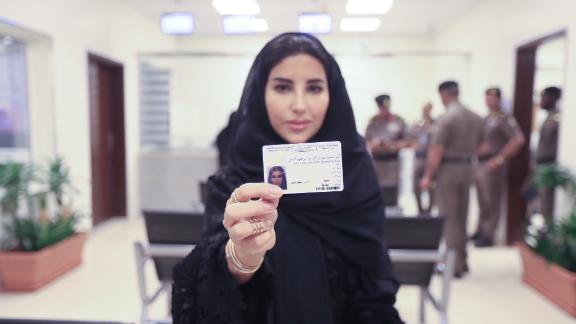 Esraa Albuti, an Executive Director at Ernst & Young, holds her new driving licence  issued by the Kingdom of Saudi Arabia.