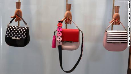 Kate Spade & Co. handbags are displayed this year outside the Lumine Co. shopping center in Yokohama, Japan.