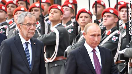 Austria's President Alexander van der Bellen (left) and Russian President Vladimir Putin inspect a military honor guard at the Presidential palace in Vienna, Austria, on Tuesday.