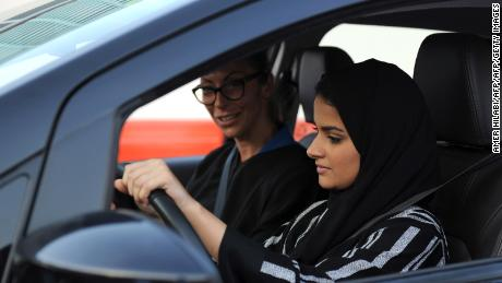 A Saudi woman (front) receives a driving lesson from an Italian instructor in Jeddah on March 7, 2018. Saudi Arabia's historic decision in September 2017 to allow women to drive from June has been cheered inside the kingdom and abroad -- and comes after decades of resistance from female activists, many of whom were jailed for flouting the ban. / AFP PHOTO / Amer HILABI        (Photo credit should read AMER HILABI/AFP/Getty Images)