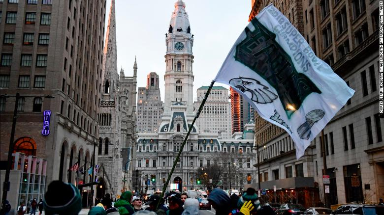 PHILADELPHIA, PA - FEBRUARY 08: Eagles fans wave a flag outside City Hall before festivities begin on February 8, 2018 in Philadelphia, Pennsylvania. The city celebrated the Philadelphia Eagles' Super Bowl LII championship with a victory parade. (Photo by Corey Perrine/Getty Images)