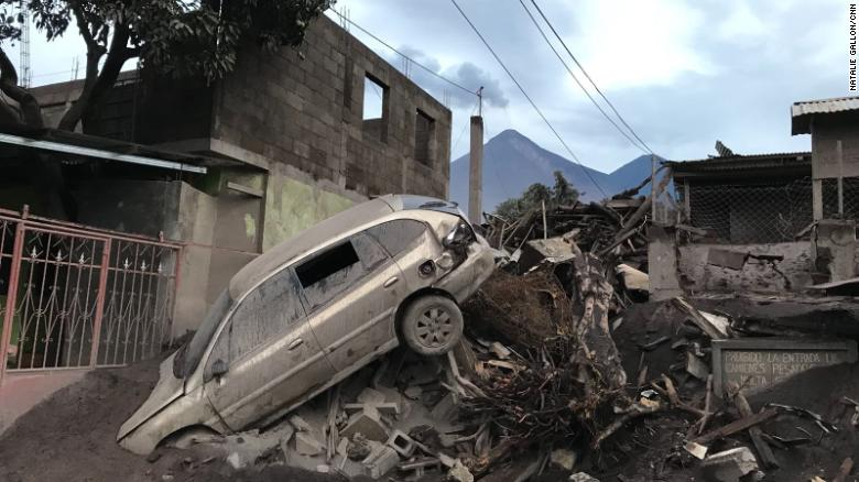 An abandoned car rests atop debris in El Rodeo, Guatemala, on Wednesday, three days after the nearby Fuego volcano erupted.