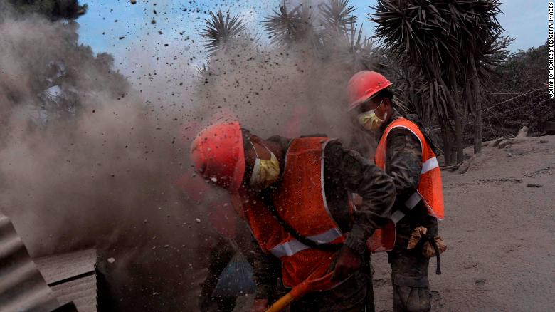 Members of the Guatemalan Army search for volcano victims Tuesday, June 5, in the ash-covered village of San Miguel Los Lotes.