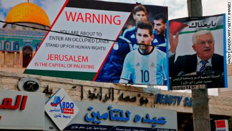 A picture taken on Tuesday shows a poster erected on a main street in Hebron denouncing the fixture between Argentina and Israel.