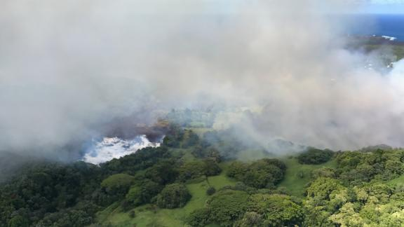 A Hawaii County Fire Department photo shows how lava flows evaporated the waters of Green Lake.