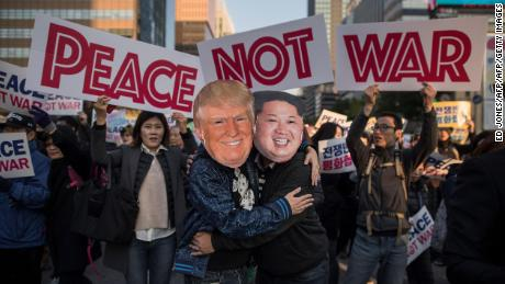 TOPSHOT - Demonstrators dressed as North Korean leader Kim Jong-Un (R) and US President Donald Trump (L) embrace during a peace rally in Seoul on November 5, 2017. Thousands of South Koreans called for peace in a protest against an upcoming visit by Donald Trump as he begins a two-week Asia tour amid tension over North Korea's weapons drive.  / AFP PHOTO / Ed JONES        (Photo credit should read ED JONES/AFP/Getty Images)
