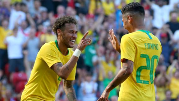 LIVERPOOL, ENGLAND - JUNE 03:  Firmino of Brazil celebrates after scoring his sides second goal with Neymar Jr of Brazil during the International Friendly match between Croatia and Brazil at Anfield on June 3, 2018 in Liverpool, England.  (Photo by Alex Livesey/Getty Images)