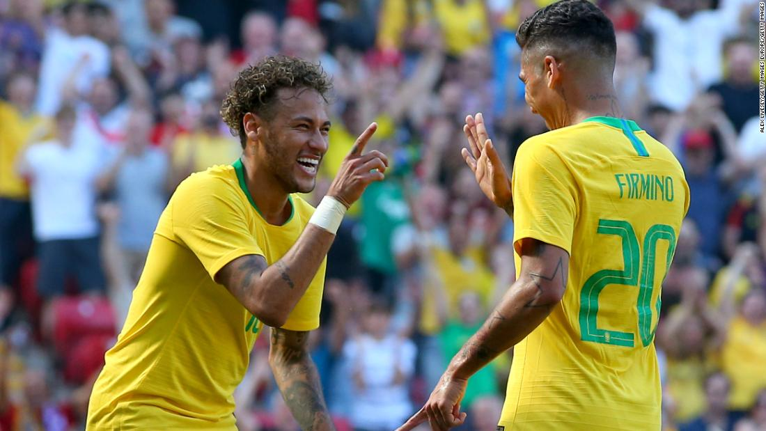 Brazil teammates Neymar and Roberto Firmino celebrate during a friendly against Croatia this month. If forecasts are right, the two attackers will be celebrating in Moscow at the World Cup final on July 15.