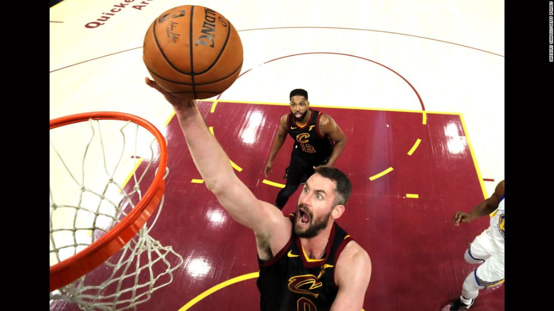 Cleveland's Kevin Love lays the ball in during the first half of Game 3. Love had 15 points and 10 rebounds by halftime as the Cavaliers had a 6-point lead.