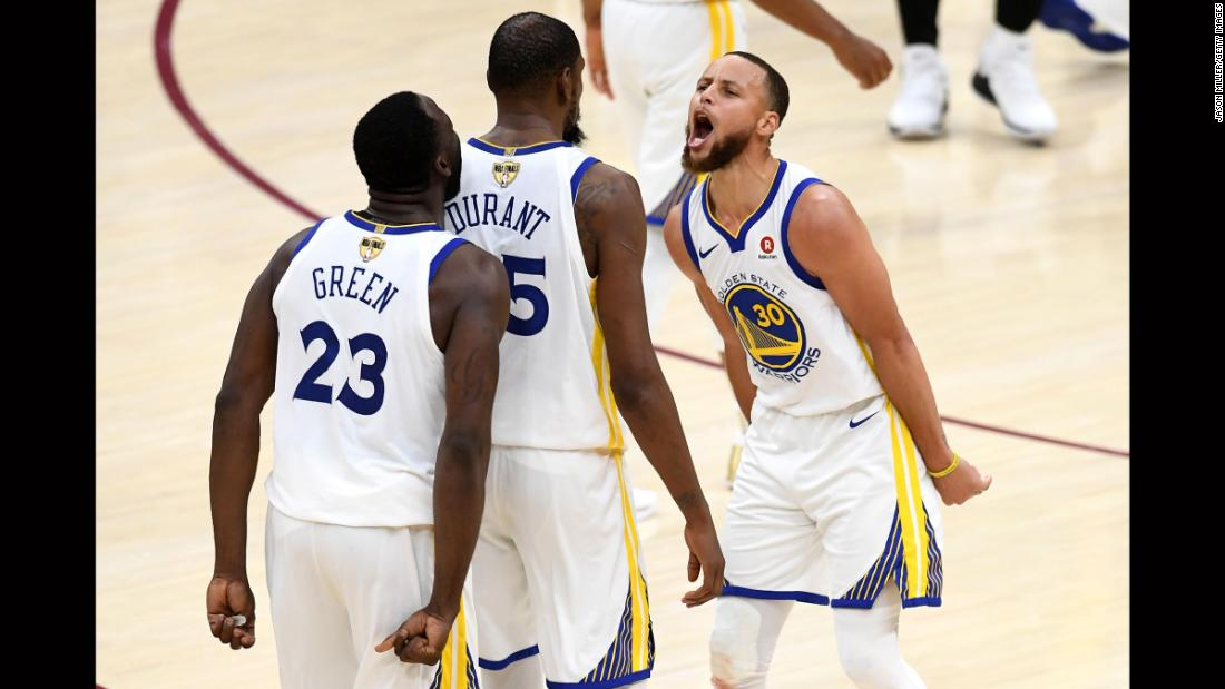 Curry and Green celebrate with Durant after Durant hit a big shot late in Game 3.