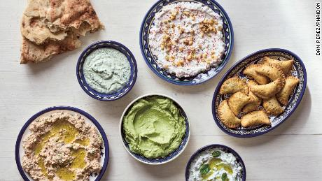 Dips and Small Bites: clockwise from left: Taboon Bread; Parsley or Cilantro (Coriander) Tahini Spread; Walnut and Garlic Labaneh; Deep-Fried Cheese and Za'atar Parcels; Garlic and Cucumber Labaneh; Avocado, Labaneh, and Preserved Lemon Spread; Labaneh And Bulgur Spread.