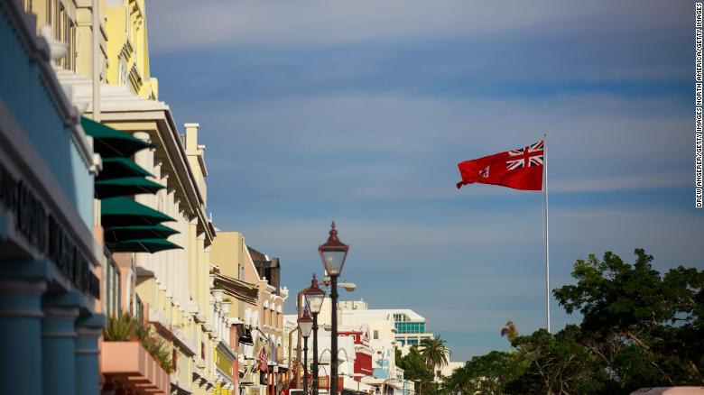 The flag of Bermuda flies along the commercial and retail district in Hamilton, Bermuda on November 8, 2017.
