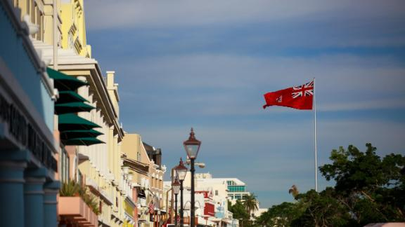 The flag of Bermuda flies over the commercial and retail district in Hamilton, Bermuda, in November  2017.