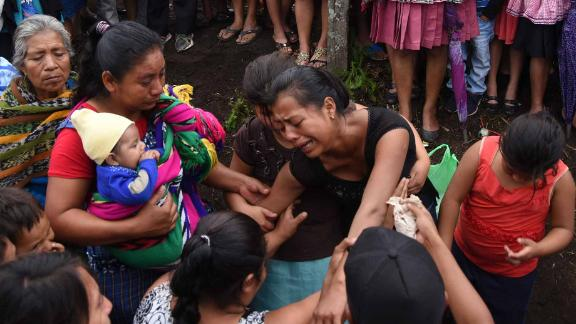 Relatives of 20-year-old victim Erick Rivas mourn his death during his funeral in Alotenango on June 6.