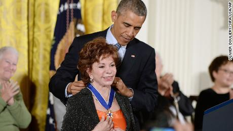 President Barack Obama presents the Medal of Freedom to Isabel Allende in 2014.