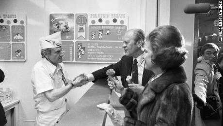President Ford shakes hands with a server behind the counter at a Baskin-Robbins in New Hampshire in 1976.