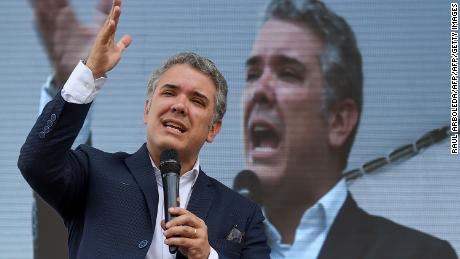 Colombia's presidential candidate for the Democratic Center Party Ivan Duque, delivers a speech during a meeting with the textile sector in Bogota, on May 3, 2018. - Colombia will hold presidential elections on May 27. (Photo by Raul ARBOLEDA / AFP)        (Photo credit should read RAUL ARBOLEDA/AFP/Getty Images)