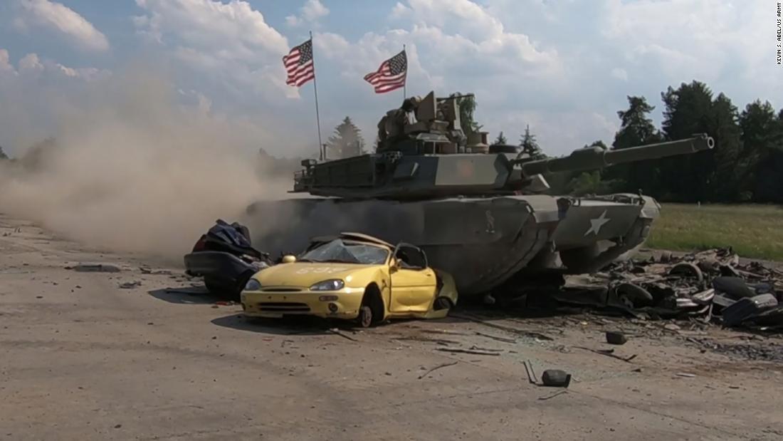 Watch Army Tanks Crush Cars