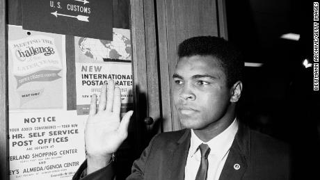 (Original Caption) 04/28/67-Houston: Heavyweight champion Cassius Clay waves at fans as he arrives at Army Induction Center where he is scheduled to be inducted into the Army. Clay has said he will refuse induction thereby leaving himself open to criminal prosecution.
