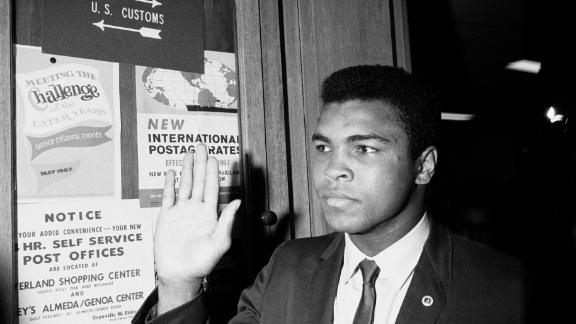 Muhammad Ali, then also known as Cassius Clay, at the Army Induction Center where he was scheduled to be inducted into the Army. He refused induction thereby leaving himself open to criminal prosecution.