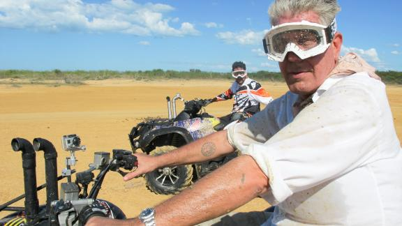 "Bourdain rides an all-terrain vehicle in Colombia while filming ""Parts Unknown."" The CNN show premiered in 2013."