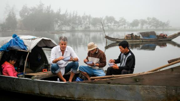 "Bourdain enjoys a bite of food while on location in Vietnam. While accepting a Peabody Award for ""Parts Unknown"" in 2013, Bourdain said: ""We ask very simple questions: What makes you happy? What do you eat? What do you like to cook? And everywhere in the world we go and ask these very simple questions. We tend to get some really astonishing answers."""