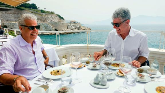 Bourdain and chef Eric Ripert have lunch in Marseille, France, in 2015. Ripert was the person who found Bourdain unresponsive in his hotel room in 2018.