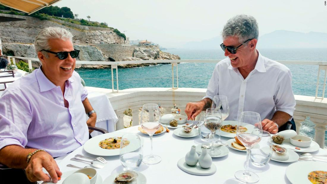 Bourdain and chef Eric Ripert have lunch in Marseille, France, in 2015. Ripert was the person who found Bourdain unresponsive in his hotel room Friday.