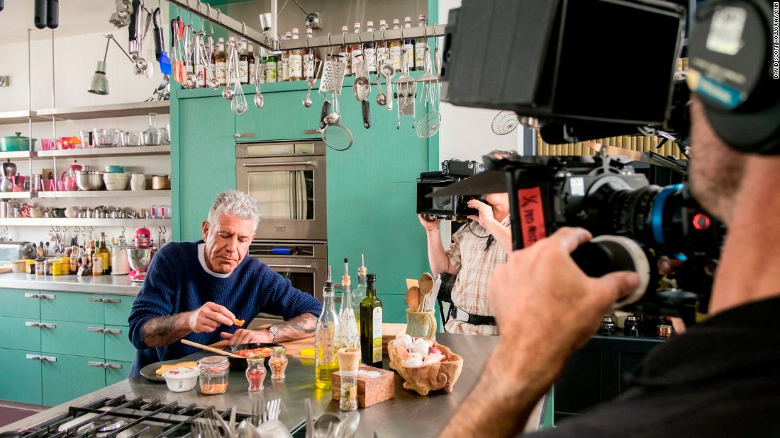 "Bourdain enjoys a ""hangover cure"" breakfast that chef Nigella Lawson made for him at her home in London in 2016."