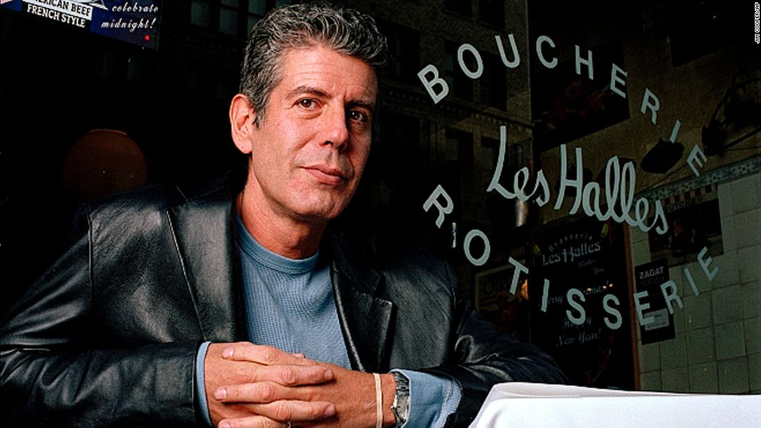 "Bourdain sits at his New York City restaurant Brasserie Les Halles in 2001. The Smithsonian once called Bourdain ""the original rock star"" of the culinary world."