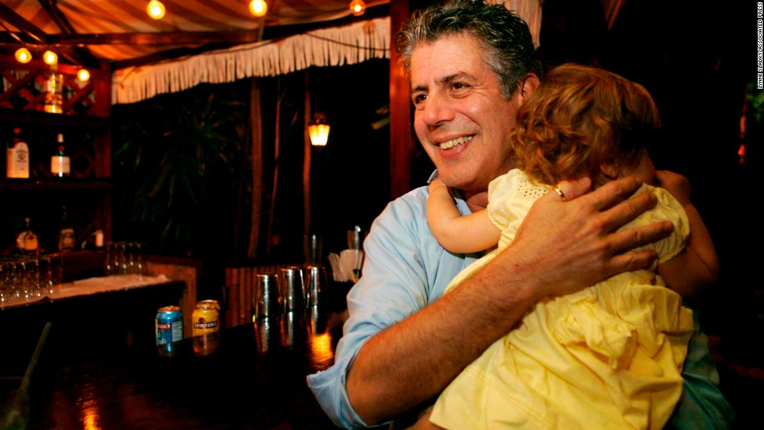 Bourdain holds his daughter, Ariane, in 2008. Ariane was his only child.