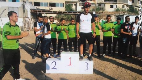 Alaa Al-Dali (C) qualified to be part of the Palestinian cycling team for Asia games. Then he lost his leg during a protest.