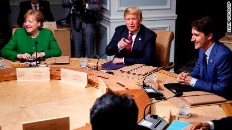German Chancellor Angela Merkel, President Donald Trump, and Canadian Prime Minister Justin Trudeau participate in a G-7 summit working session, Friday, June 8, 2018, in Charlevoix, Canada. (AP Photo/Evan Vucci)