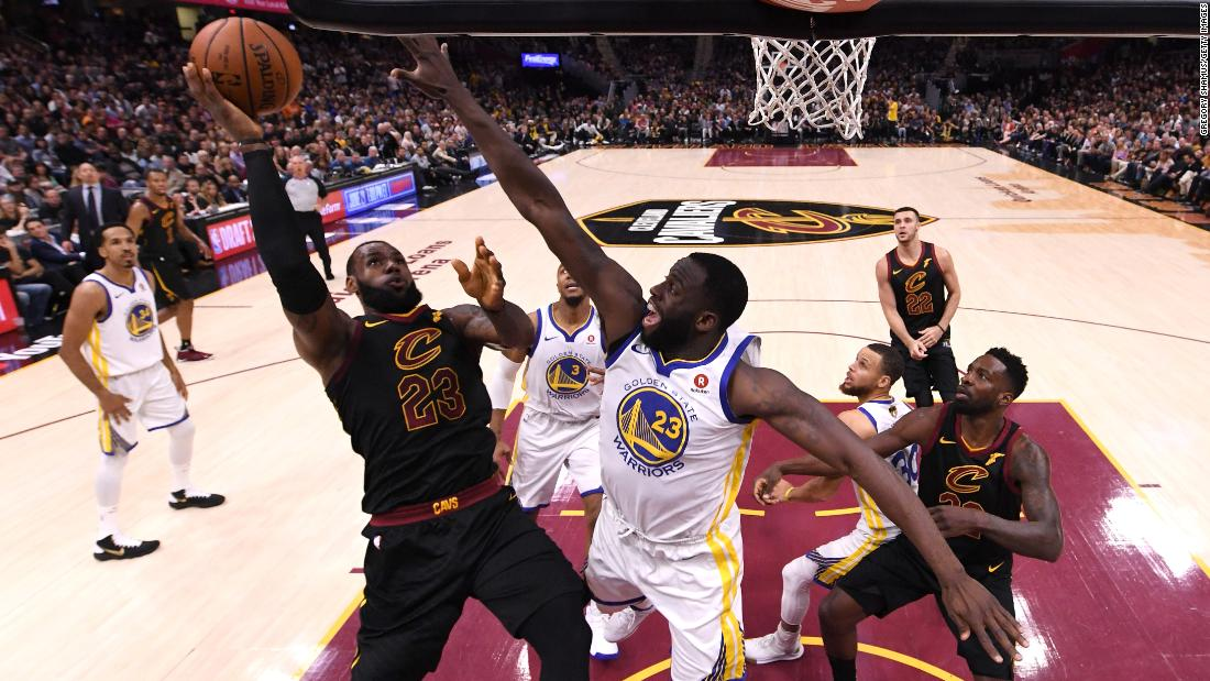 Cleveland's LeBron James is defended by Golden State's Draymond Green during the first half of Game 4. This was the fourth straight season that the two teams met in the Finals. Golden State also won the title in 2015 and 2017. Cleveland won in 2016.