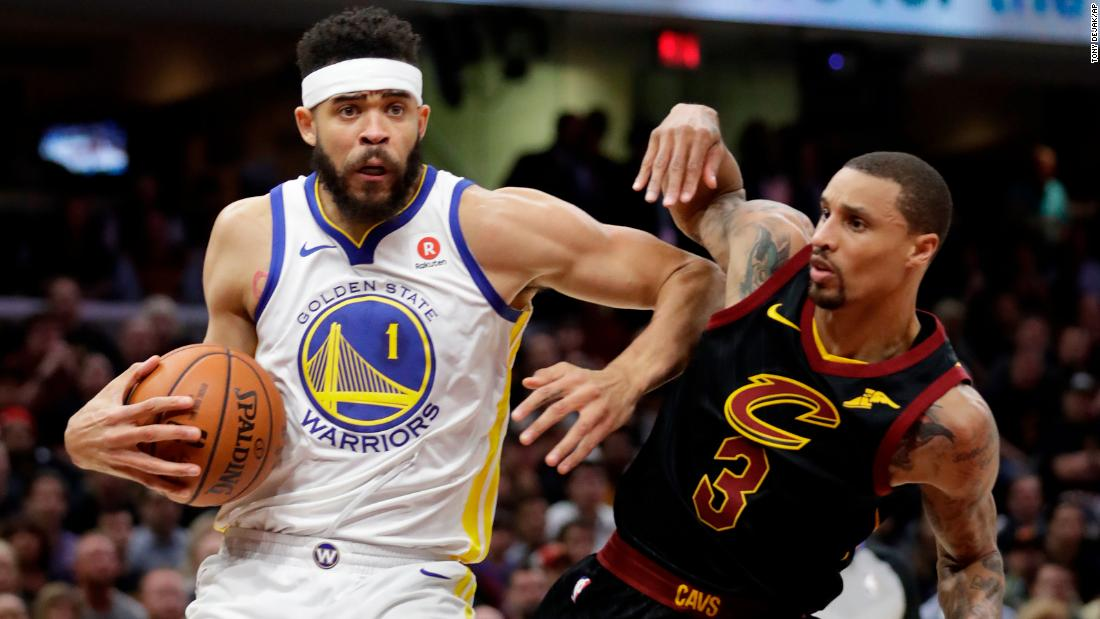 Golden State center JaVale McGee drives past George Hill.