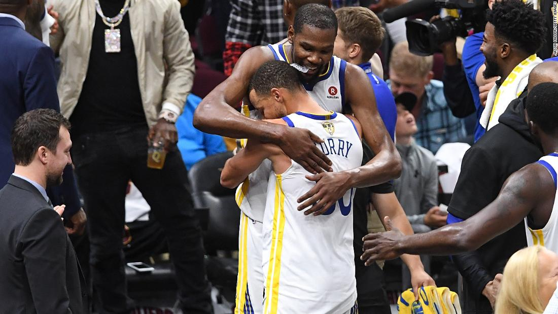 Kevin Durant hugs Golden State teammate Stephen Curry after the game. Durant was named NBA Finals MVP for the second straight season.