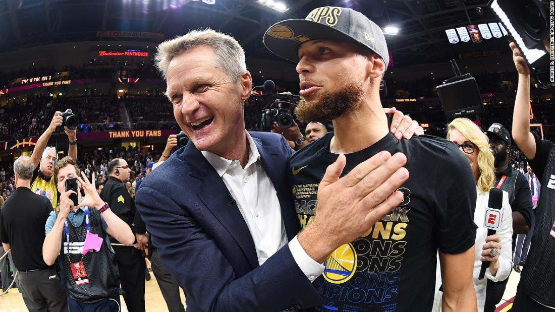 Curry and Warriors head coach Steve Kerr share a moment during the celebration. Kerr has now won eight NBA titles -- five as a player and three as a coach.