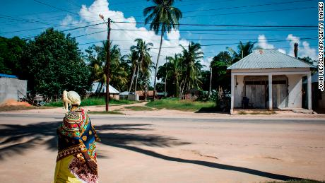 A Mozambican woman walks in the small fishing town of Palma, envisioned as a center for liquefied natural gas development, in February 2017.