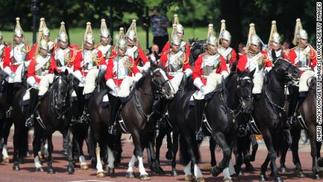 Members of the Queen's personal troops, the Household Division, march on the Mall on Saturday.