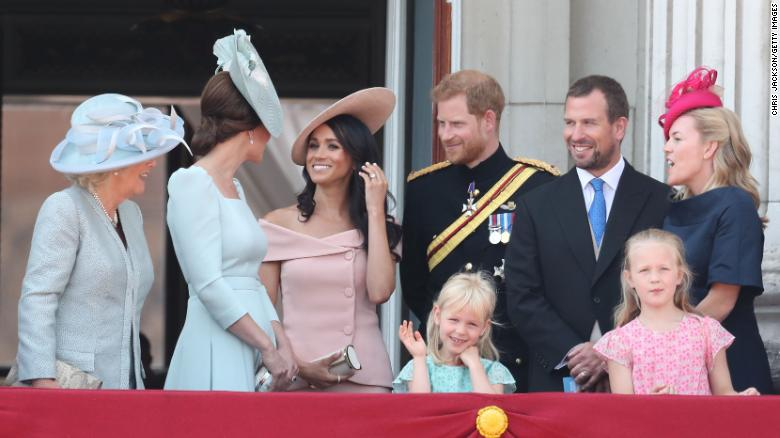 (L-R) The Duchess Of Cornwall, Duchess of Cambridge, Duchess of Sussex, Duke of Sussex, Peter Phillips, Autumn Phillips and their children Isla and Savannah Phillips on the balcony of Buckingham Palace in 2018.