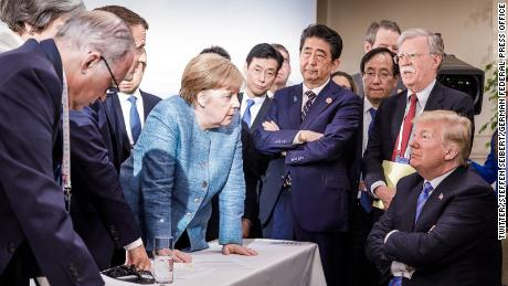 Heads of state of G7 nations peer down at Trump during the summit in Canada.