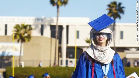 Riley McCoy wore a special protective hood so she could take part in the outdoor ceremony.