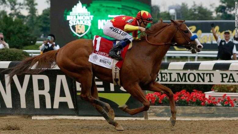 ELMONT, NY - JUNE 09:  Justify #1, ridden by jockey Mike Smith leads the field to the finish line to win the 150th running of the Belmont Stakes at Belmont Park on June 9, 2018 in Elmont, New York.  Justify becomes the thirteenth Triple Crown winner and the first since American Pharoah in 2015. (Photo by Michael Reaves/Getty Images)