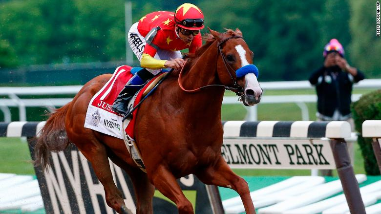 Justify (1), with jockey Mike Smith up, crosses the finish line to win the 150th running of the Belmont Stakes horse race and the Triple Crown, Sunday, June 10, 2018, in Elmont, N.Y. (AP Photo/Peter Morgan)